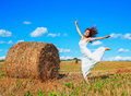 Beautiful woman in the harvested  wheat field Royalty Free Stock Photo