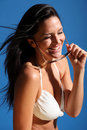 Beautiful woman has bikini fun and laughter in sun Royalty Free Stock Photo