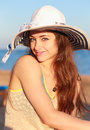 Beautiful woman in hat with long hair on the beach closeup portrait Royalty Free Stock Image