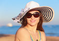 Beautiful woman in hat looking on blue sea and sky background closeup portrait Royalty Free Stock Image