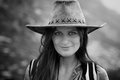 Beautiful woman with hat monochrome portrait of a over a mountain landscape Stock Images