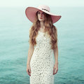 Beautiful woman in hat on the sea Royalty Free Stock Photo