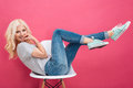 Beautiful woman having fun on the chair Royalty Free Stock Photo