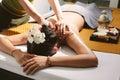 Beautiful woman having a wellness back massage. Royalty Free Stock Photo