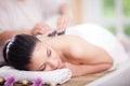Beautiful woman having a wellness back massage at spa salon Royalty Free Stock Photo