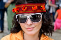Beautiful woman in a headband closeup portrait of smiling and trendy sunglasses Stock Images