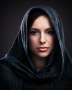 Beautiful woman with headscarf portrait of a mysterious women wearing a Royalty Free Stock Photo