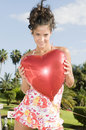 Beautiful woman with heart ballon in Valentine Day Royalty Free Stock Photography