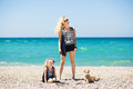 Beautiful woman, her charming daughter and terrier dog resting on the beach Royalty Free Stock Photo