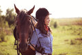 Beautiful woman with her horse Royalty Free Stock Photo