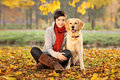 Beautiful woman and his dog (Labrador retriever) Royalty Free Stock Photos