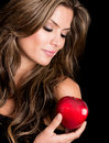 Beautiful woman holding apple tempation isolated over black Royalty Free Stock Photography