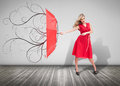 Beautiful woman holding a broken umbrella in an empty room with wooden boards Stock Images