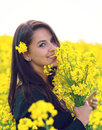 Beautiful Woman  holding a bunch of rape flowers Royalty Free Stock Photo