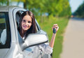 Beautiful woman holding car keys and smiling Royalty Free Stock Image