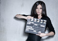 Beautiful woman holding clapperboard Royalty Free Stock Photo