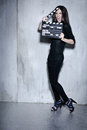 Beautiful woman holding clapperboard Stock Photos