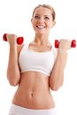 Beautiful woman holding dumbbells Royalty Free Stock Photos