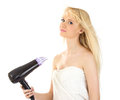 Beautiful woman holding hair dryer Stock Photography