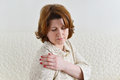 Beautiful woman holding her hand on sore shoulder Royalty Free Stock Photo