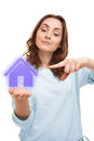Beautiful woman holding a house sign on her palm violet Royalty Free Stock Photo