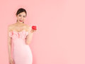Beautiful woman holding mini heart on hand,fashion girl on pink Royalty Free Stock Photo