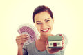 Beautiful woman holding money and house. Royalty Free Stock Photo