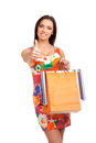 Beautiful woman holding shopping bags gesturing thumb up Stock Photo