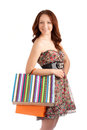 Beautiful woman holding shopping bags isolated over white background Stock Images