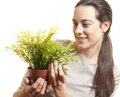 Beautiful woman holding a small plant Stock Photo