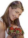Beautiful woman holding strawberries Royalty Free Stock Image