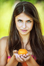 Beautiful woman holding tangerine Stock Photography