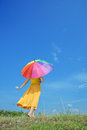 Beautiful woman holding umbrella and blue sky Royalty Free Stock Image