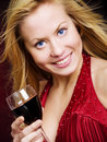 Beautiful woman holding wine Stock Images
