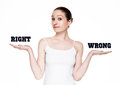 Beautiful woman holding words right and wrong Royalty Free Stock Photo