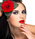 Beautiful woman holds the red rose portrait of a brunette with nails and lips Stock Image