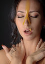Beautiful woman with honey mask over darkgray Stock Photos