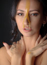 Beautiful woman with honey mask over darkgray Royalty Free Stock Photography