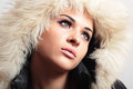 Beautiful woman in hood white fur winter style fashion girl portrait of Stock Photography