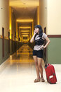 Beautiful woman in hotel corridor Stock Photo