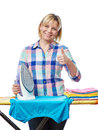Beautiful woman housewife ironed clothes and showing thumbs up isolated on white Stock Photos