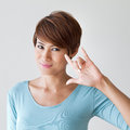 Beautiful woman with I love you hand sign gesture Royalty Free Stock Photo