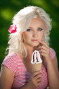 Beautiful woman with ice cream outdoors girl eating icecrea in park summer vacation pretty blond on nature happy smiling woman Royalty Free Stock Photos