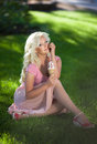 Beautiful woman with ice cream outdoors girl eating icecrea in park summer vacation pretty blond on nature happy smiling woman Stock Photos