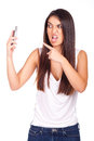 Beautiful woman irritated by the phone Stock Photo