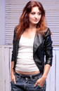 Beautiful woman in jeans and black leather jacket Royalty Free Stock Photo