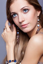 Beautiful woman in jewelry and  bijouterie Royalty Free Stock Photo