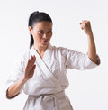 Beautiful woman in kimono on white asian show block martial art exercise Stock Photos