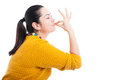 Beautiful woman kissing her fingers