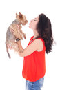 Beautiful woman kissing his little dog yorkshire terrier isolate Stock Photos